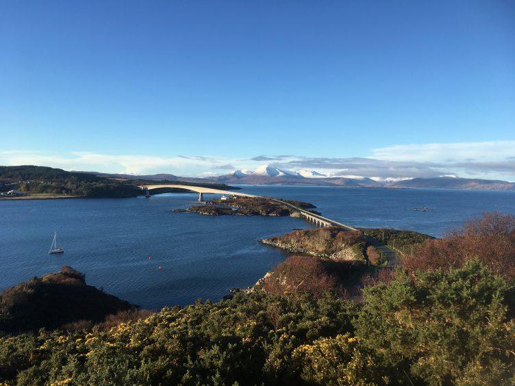 The view across the Skye Bridge to the snowy Cuillin mountain range. Photograph: James Gordon