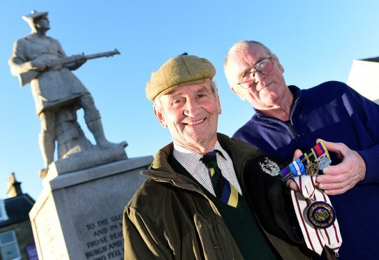 Deputy Lieutenant Mike Taitt (left) had his medals returned to him by Jim Leask after he lost them on remembrance sunday.      Picture by Kami Thomson