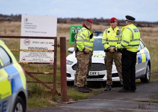 Police Scotland and Military Police at the gates to the range in Tain