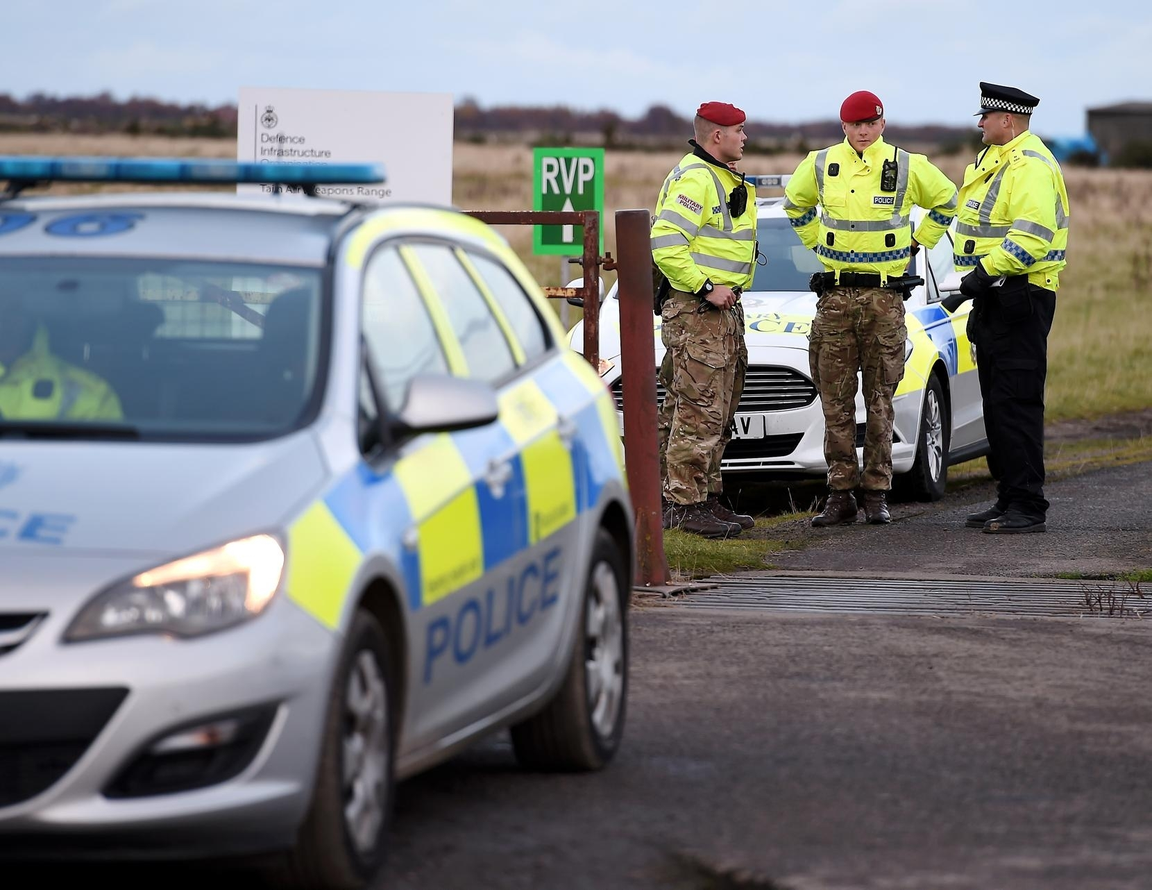 Police Scotland and Military Police at the gates to the ranges in Tain after the incident.