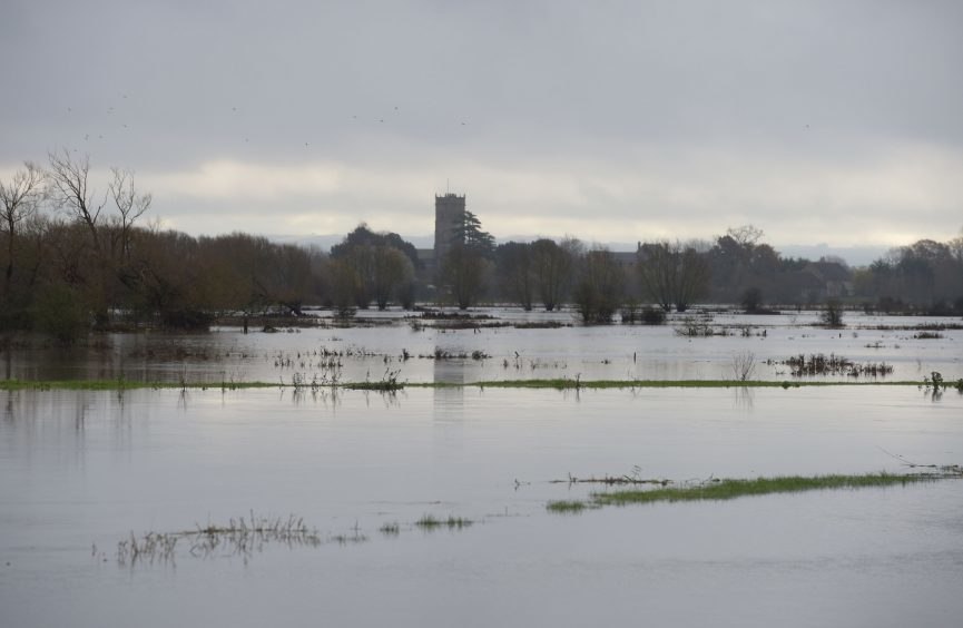 Flooding on the Somerset Levels in front of Muchelney Abbey as heavy rain, strong winds and flash flooding have brought widespread disruption across the country.