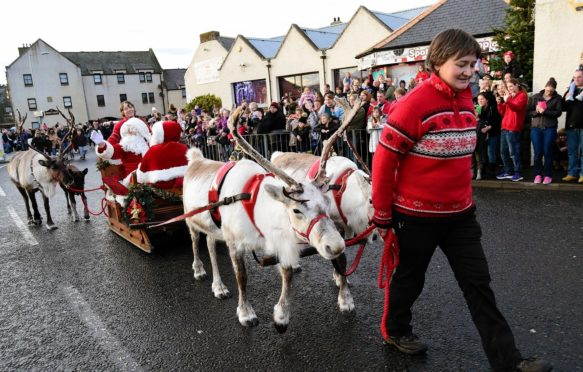 Santa and his reindeer drew hundreds of revelers to Banff's historic town centre.
