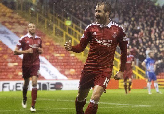 Aberdeen's Niall McGinn netted the winner deep in injury time.