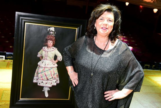 Elaine C Smith at HMT with her panto dame portrait  behind her