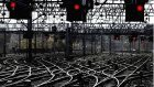 File photo of signal lights all turned to red and lines standing empty at Glasgow Central station.