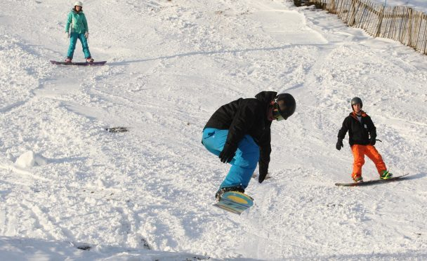 Skiers and snowboarders at The Lecht