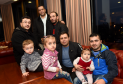 Members of the Aberdeen Syrian refugee community, and translator Bahaa Mahmoud, rear