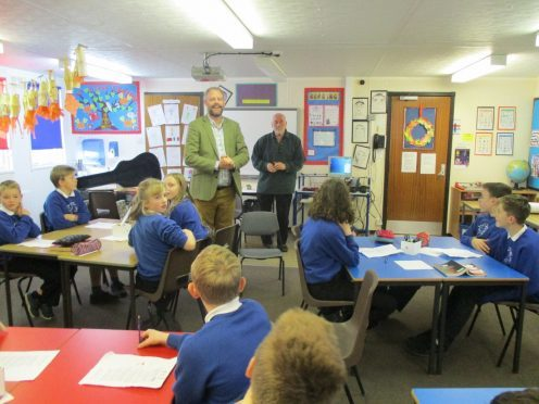 Neil McLennan (front) and Dave Ramsay help produce pupils podcast at Catterline School