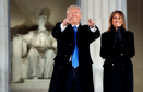 "President-elect Donald Trump, left, and his wife Melania Trump arrive to the ""Make America Great Again Welcome Concert"" at the Lincoln Memorial"