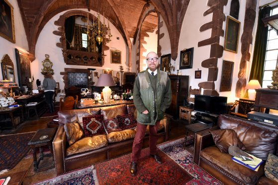 Marc Ellington inside his home, Towie Barclay Castle, which he completely restored