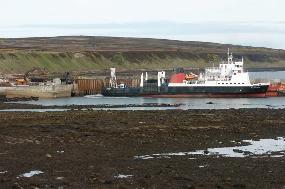 A ferry boat leaving Gills Bay destined for St Margaret's Hope on Orkney