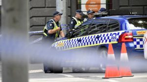 Police man a roadblock near the site where a car struck pedestrians in the central business district of Melbourne (AP Photo/Andrew Brownbill)