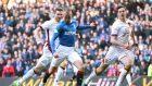 Rangers' Kenny Miller slots home the winner against Motherwell on Saturday
