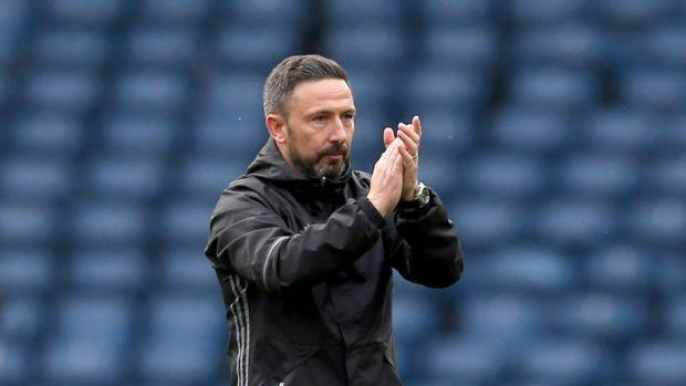 Aberdeen boss Derek McInnes has not commented on rumours linking Stevie May with a move