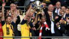 Arsene Wenger, right, has lifted the FA Cup with Arsenal a record-equalling six occasions