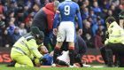 Rangers striker Joe Garner was stretchered off against Celtic