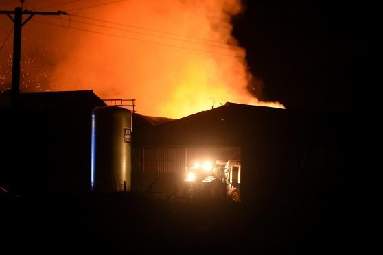 The scene of farm fire at Nigg in Easter Ross which is believed to have involved a combine harvester and a large quantity of bales. Pics by Sandy McCook.