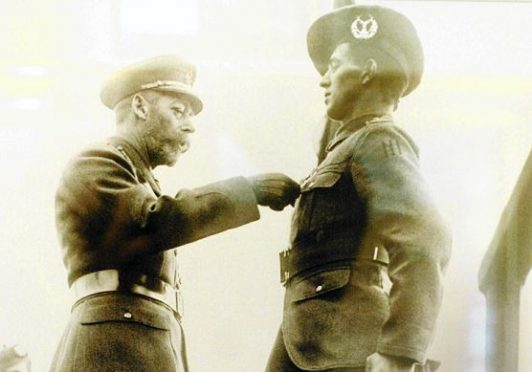 Private George McIntosh being awarded the Victoria Cross by King George V