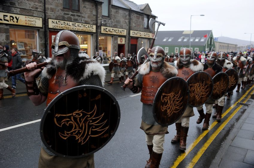 Guizer Jarl Lyall Gair leads his squad through the streets of Lerwick.