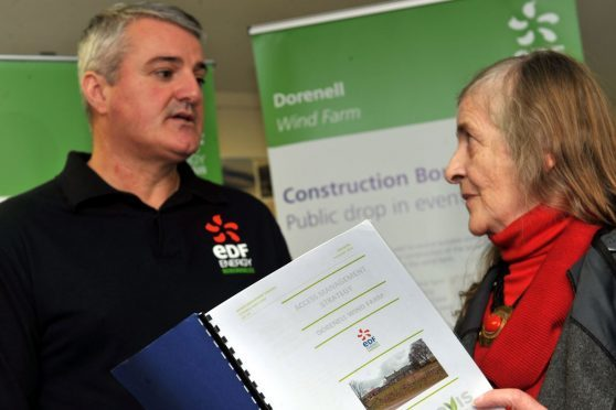 Dufftown resident Jean Oliver, right, confronts EDF's project manager Darren Cuming about the plans.