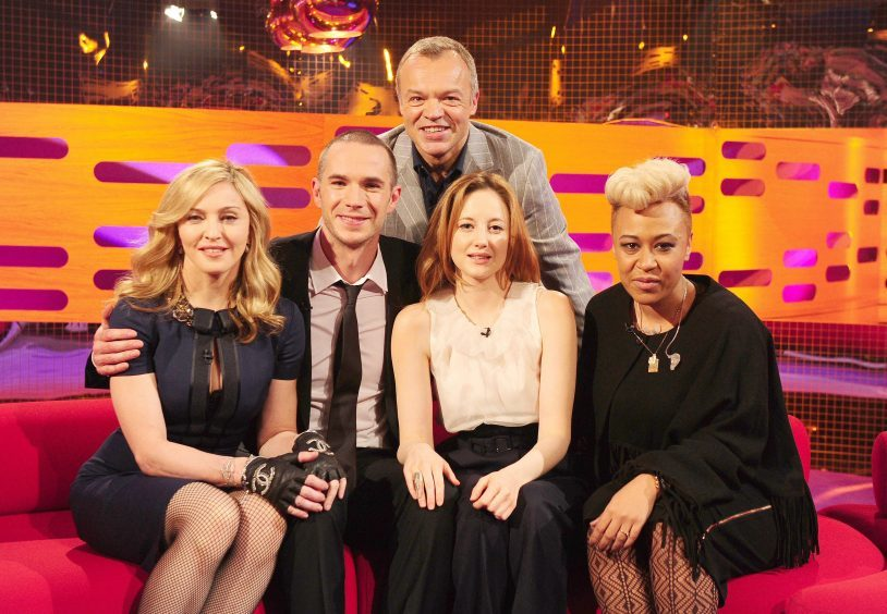(From the left) Madonna, James D'Arcy, Andrea Riseborough and Emeli Sande pose with host Graham Norton in 2012