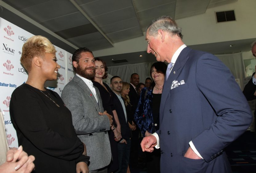 The Prince of Wales speaks with Tom Hardy, Emeli Sande (left) and Keeley Hawes (third left) during The Prince's Trust and L'Oreal Paris Celebrate Success Awards in 2012.
