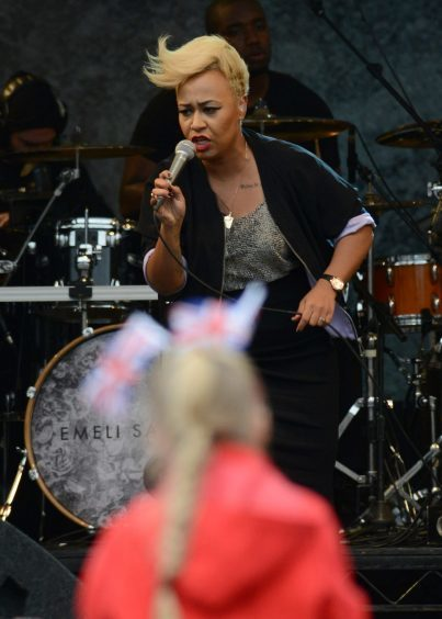 Emeli Sande on stage in George Square, Glasgow, Scotland in front of 16,000 people before the Olympic torch was brought onto the stage.