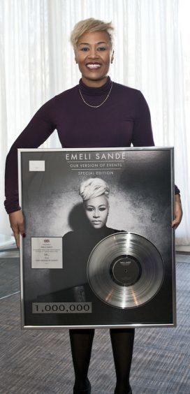 Emeli Sande with disc celebrating her 1 million album sales in 2012.