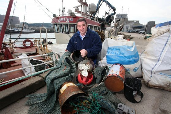 Jimmy Buchan, skipper of the langoustine trawler the Amity at Peterhead harbour
