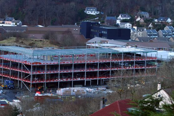 The construction of the new oban high school with the existing oban high school in the background picture kevin mcglynn