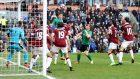 Sean Raggett heads Lincoln's winner at Burnley