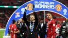 Chris Smalling, right, celebrates United's cup win alongside David De Gea