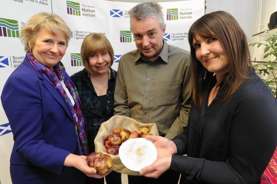 Environment Secretary Roseanna Cunningham with Jane Robertson, Glenn Bryan and Gaynor McKenzie from the Commonwealth Potato Collection.