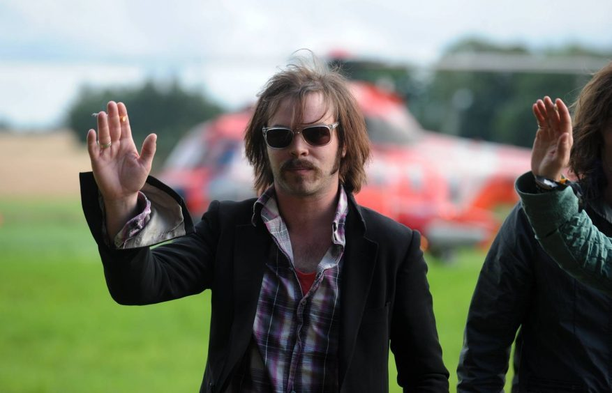 Gaz from headlining act Supergrass arriving by helicopter at the Wizard festival in New Deer in 2008.