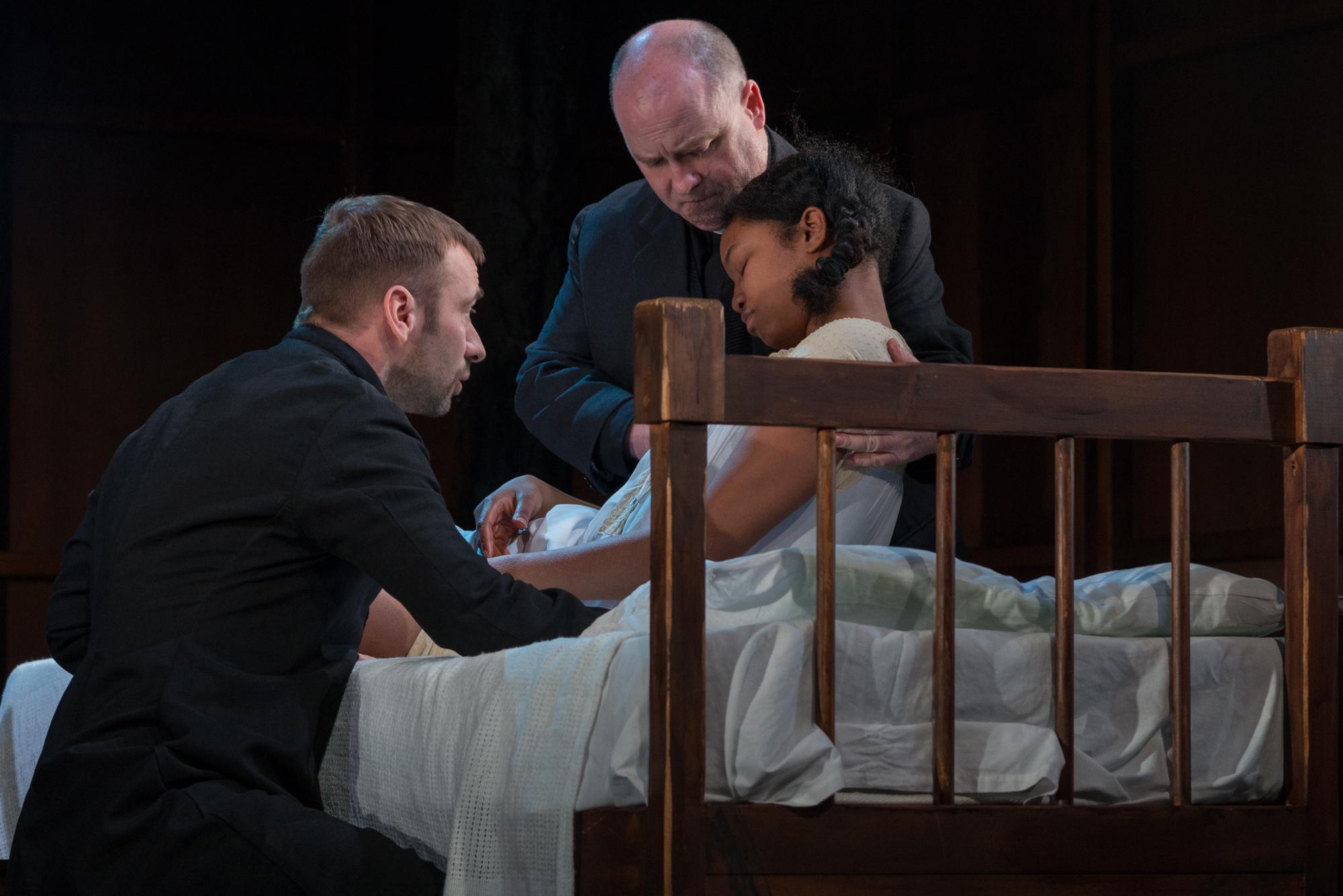 11 . Charlie Condou as Reverand Hale_Cornelius Clarke as Reverend Parris_Leona Allen as Betty Parris -®Alessia Chinazzo
