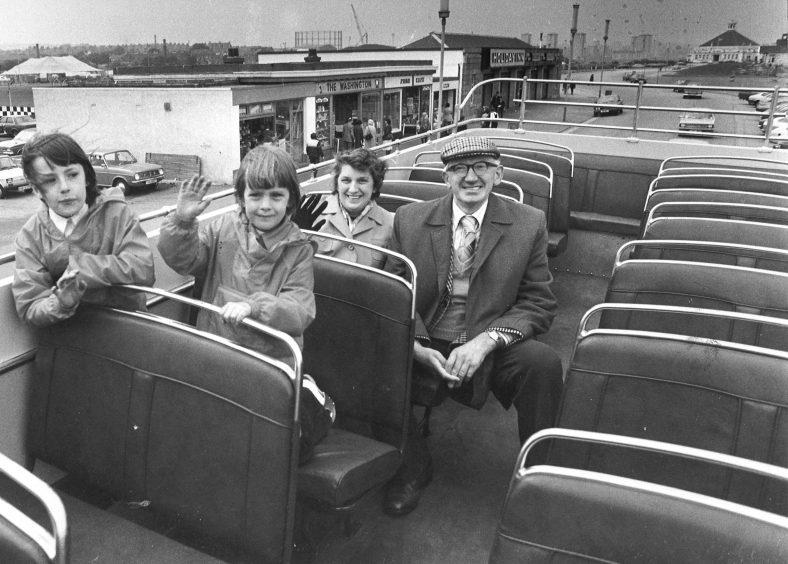 A family enjoy the open-top fun bus which went along the Esplanade