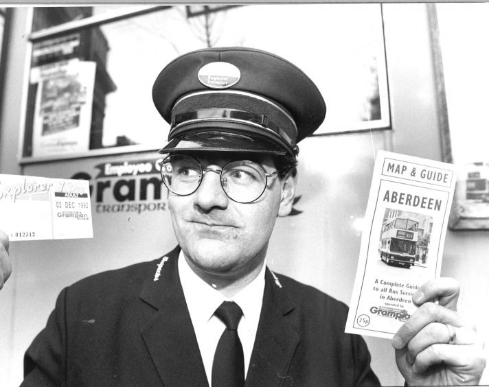 Bus inspector David Adam shows off new Cut the Rush ticket and map