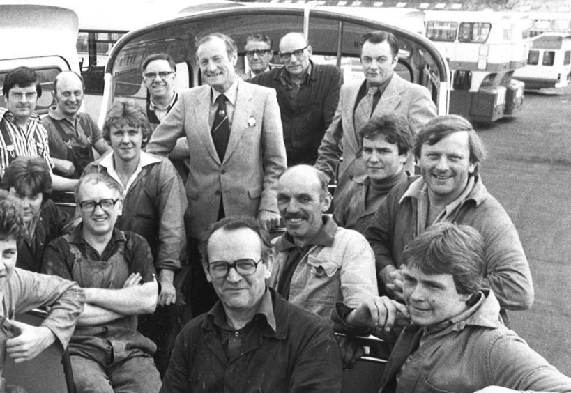 Councillor Ian Robertson with those who converted Grampian bus in 1980