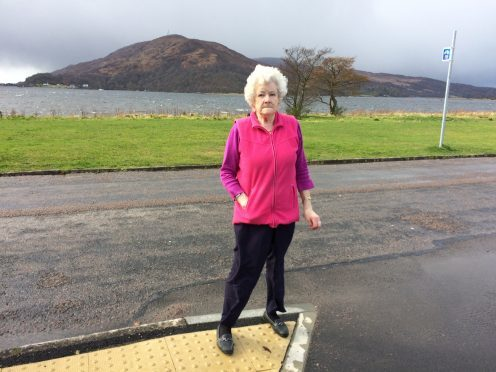 Pensioner Ena MacLeod was almost knocked down twice by cars using the access road from Caol Shopping Centre car park to nearby Erracht Drive.