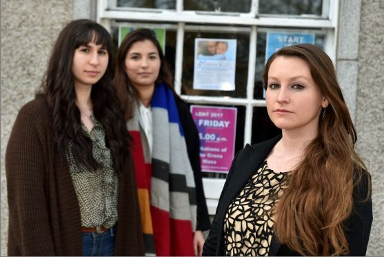 University of Aberdeen students Randi Morse, Carloto Demony and Jasmin Moussapacha are upset at pro-abortion posters in The Universities' Catholic Chaplaincy window at Old Aberdeen, High Street. Picture of (L-R) Jasmin Moussapacha, Carloto Demony, Randi Morse. Picture by KENNY ELRICK
