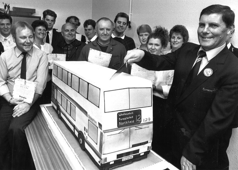 GT staff celebrate having their stake in company confirmed in 1989