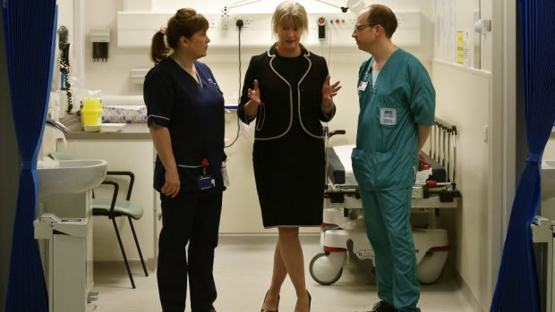 Shona Robison (centre) said NHS staff numbers have risen to record highs