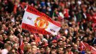 Manchester United fans heading to Russia have been advised not to wear club colours