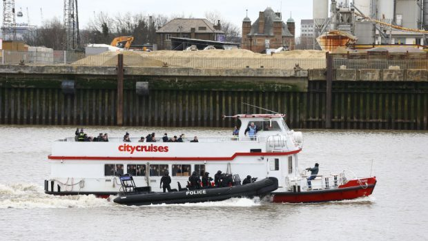 Police officers taking part in a multi-agency exercise on the River Thames in east London