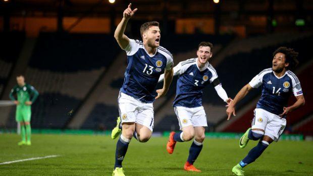 Scotland's Chris Martin, left, grabbed a late winner
