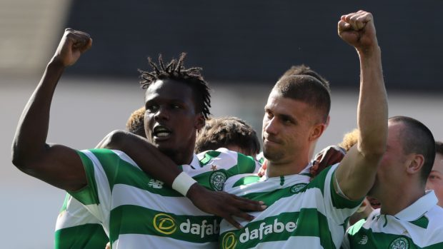 Celtic's Jozo Simunovic, right, celebrates his goal against Dundee