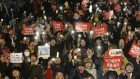 Protesters shout slogans during a rally calling for impeached president Park Geun-hye's arrest in Seoul (Ahn Young-joon/AP)