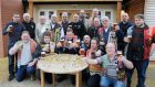 The Black Country Ale Tairsters celebrate visiting their 20,000th pub after setting off on a pub-crawl three dacades ago, at the Knot and Plough in Stafford.