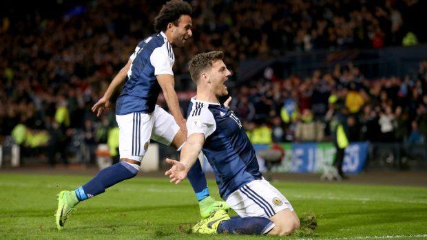 Chris Martin, right, celebrates scoring Scotland's late winner