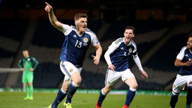 Scotland's Chris Martin, left, was delighted with his late winner